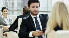 Arabic business male female technology smart phone real estate development Dubai - stock footage