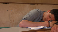 Student taking notes in lecture Stock Footage