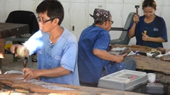 Thai people carving traditional thai art wood figure in Samutprakarn, Thailand Stock Footage