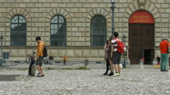 People posing for pictures in Max-Joseph-Platz Munich Stock Footage