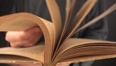 Man turning yellow pages of vintage book Stock Footage