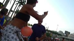 Girl dancing samba on stilts. Stock Footage