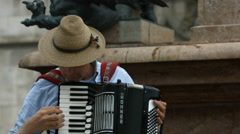 Playing an accordion and singing in Marienplatz, Munich - stock footage