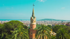 Gaudi House Museum in Park Guell and Barcelona cityscape Stock Footage