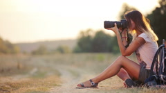Beautiful young woman journalist in the steppe. Girl with camera on nature. Stock Footage