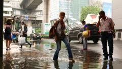 Funny woman run in shoes across puddle on city street, after rain Stock Footage