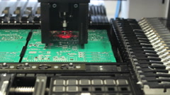 Stock Video Footage of Surface Mount Technology (Smt) Machine places elements on circuit boards
