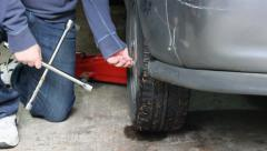Stock Video Footage of removing nuts with lug wrench