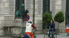 Walking and riding bikes on Residenzstrasse, Munich Stock Footage