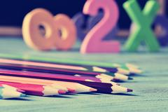 Pencil crayons, and numbers on a blue wooden table, filtered Stock Photos
