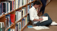 Students revising in the library Stock Footage