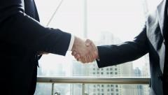 handshake multi ethnic business male stocks shares trading markets broker - stock footage