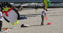 Penguin kite - People Preparing to Fly Kites of All Kinds And Shapes on - stock footage