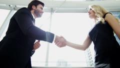 Handshake male American female Russian business real estate property development Stock Footage