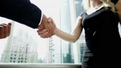 handshake male Western Caucasian Russian female business city building insurance - stock footage
