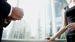 Male Western Caucasian female Eastern European business traveller global banking Stock Footage