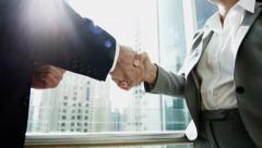 Handshake business male female stocks shares trading financial markets broker Stock Footage