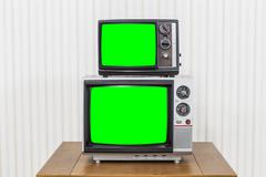 Vintage Television Stack with Chroma Key Green Screens - stock photo