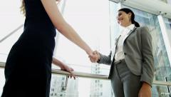 Handshake female Russian Spanish city business real estate property development Stock Footage