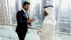 handshake European Middle Eastern business Dubai real estate property meeting - stock footage