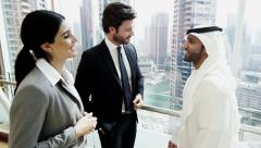 handshake Western Gulf Region business male female travel conference meeting - stock footage