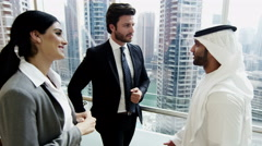 Middle East male female business team meeting stocks shares trading commodities - stock footage