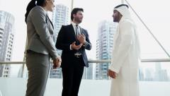 handshake Middle East male female business team meeting stocks shares trading - stock footage