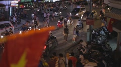 Cinerack focus - vietnamese flag to old quarter traffic Stock Footage