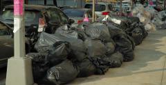 Pile of garbage bags on street zoom in Stock Footage