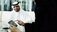 Emirati business male female technology tablet real estate development property - stock footage