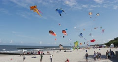 Kites Soaring in The Sky of Leba, Poland during the International Kite Stock Footage