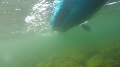 An underwater shot of sea kayak on surface of ocean Stock Footage