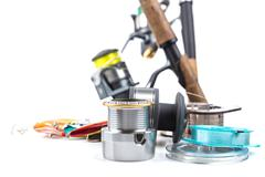 fishing tackles - rod, reel, line and lures - stock photo