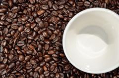 Beans and cup of coffee - stock photo