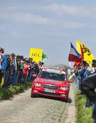 Official Red Car on the Roads of Paris Roubaix 2014 Stock Photos