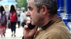 Homeless using mobile phone - stock footage