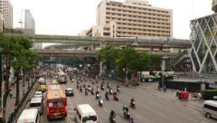 Heavy traffic flow rush through Ratchaprasong junction on green light Stock Footage