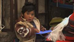Child eating in La Paz street market, Bolivia Stock Footage