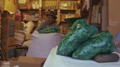 Old woman selling coca leaves in La Paz street market, Bolivia (2) Stock Footage