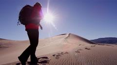 Desert female trekking sunshine businesswoman sand adventure - stock footage