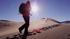 Traveller climber desert female sun adventure trek hiker - stock footage