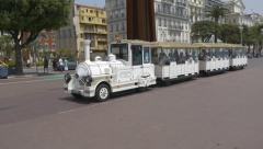 Mini tourist train on the Promenade des Anglais in Nice. Stock Footage