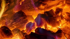 Close-up glowing coals in the fireplace with a blue flame - stock footage