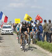 Group of Cyclists- Paris Roubaix 2014 - stock photo