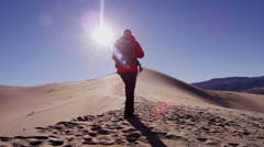 Trekking footprint desert confident exploration female Stock Footage