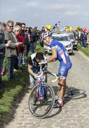 Changing the Wheel - Paris-Roubaix 2014 - stock photo