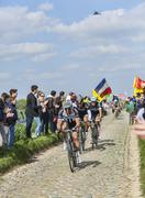 Three Cyclists on Paris-Roubaix 2014 - stock photo