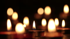 Stock Video Footage of Candles light select focus, black background.