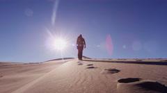 Desert female climber traveller sun sand dune adventure trek - stock footage