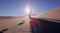 Traveller climber desert female sun adventure footprint hiker Stock Footage